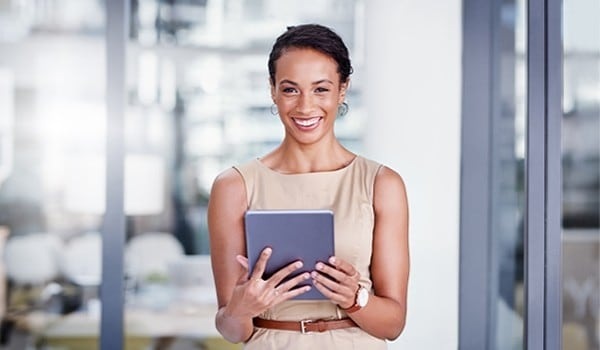 Woman with a tablet smiling