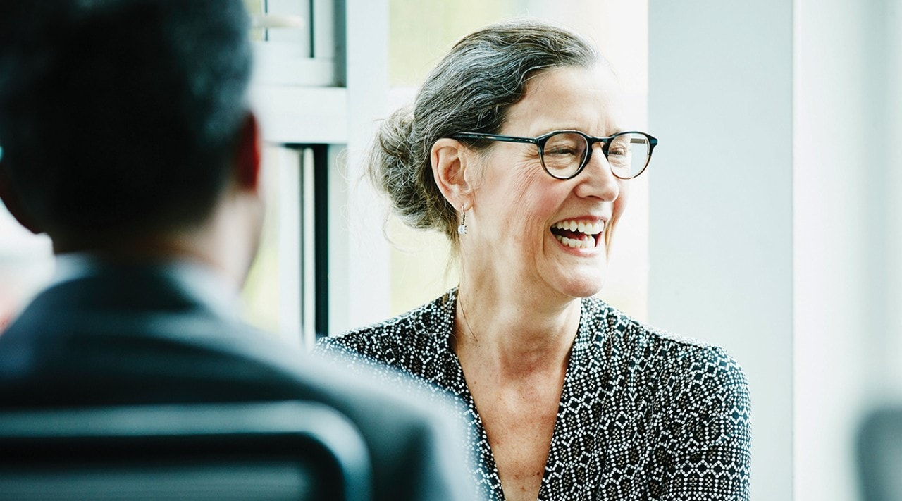 Woman laughing in a meeting