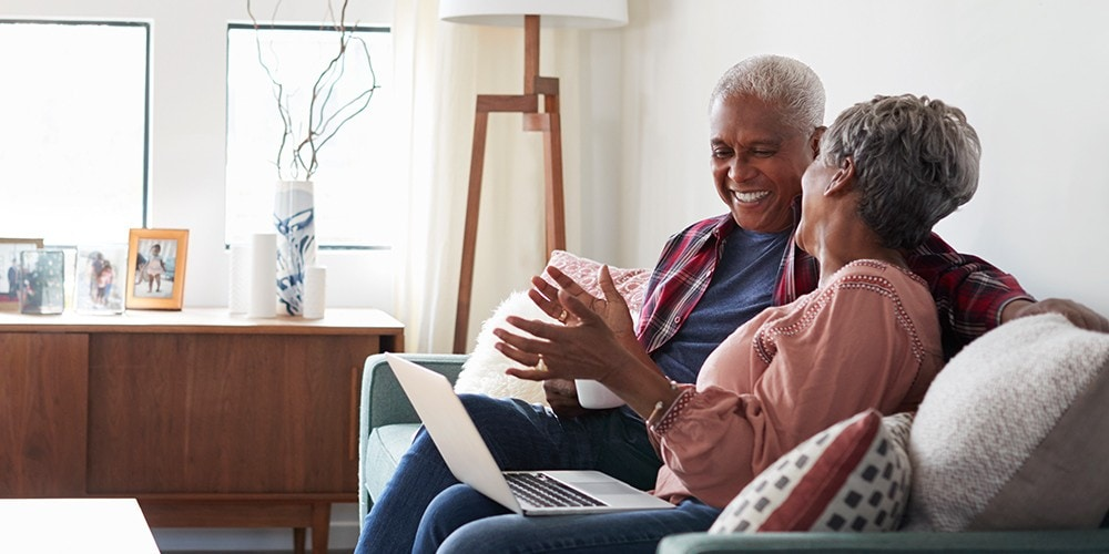 older couple laughing on couch