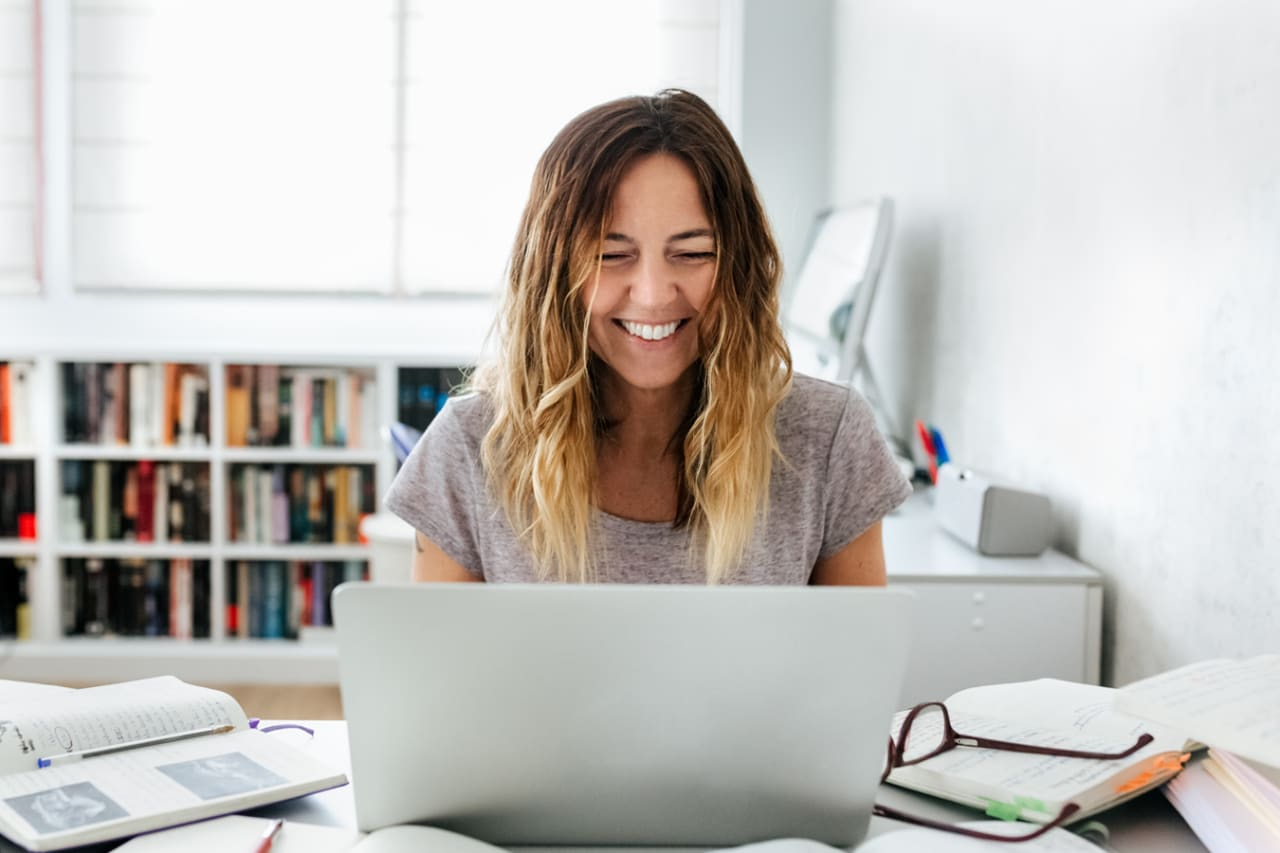Happy person checks their digital vault on a laptop