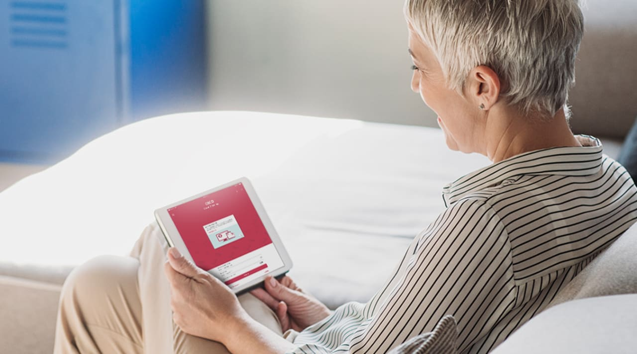 A woman does her banking on a tablet.