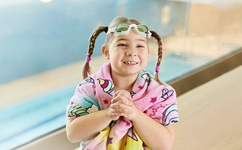 Smiling girl at pool