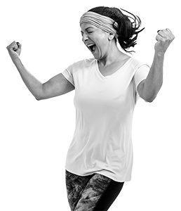 Woman running raises her arms in triumph