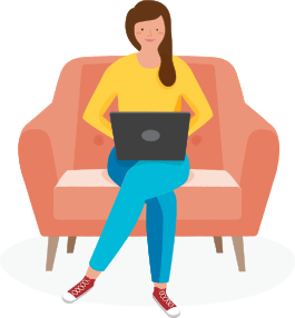 Woman browsing on a laptop while sitting on a comfy chair.