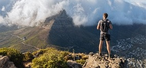 Climber conquers mountain and stands on its peak